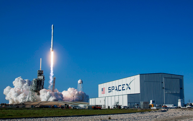 A previously flown Falcon 9 rocket flies back to space.