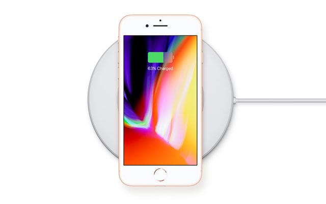 The iPhone 8 in an AirPower wireless charging mat.
