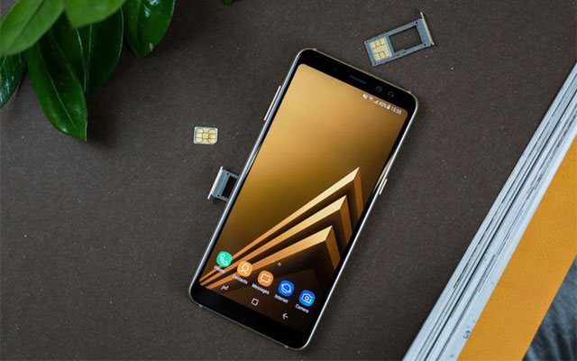 Samsung Galaxy A8 (2018) showing its card slots.