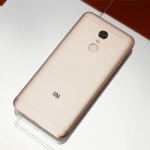 The Xiaomi Redmi 5 Plus smartphone in gold.
