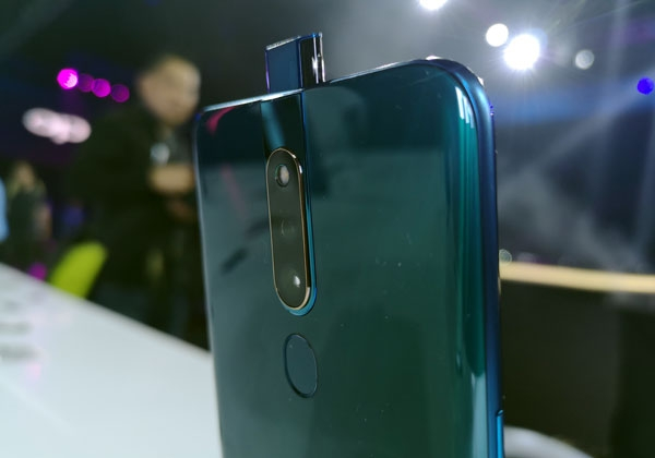 The OPPO F11 Pro's dual rear camera and rising front camera.