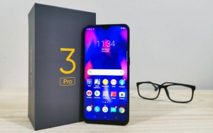 The Realme 3 Pro smartphone and its box.
