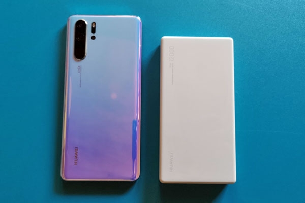 Huawei P30 Pro on the left and Huawei 12000 40W SuperCharge Power Bank on the right.