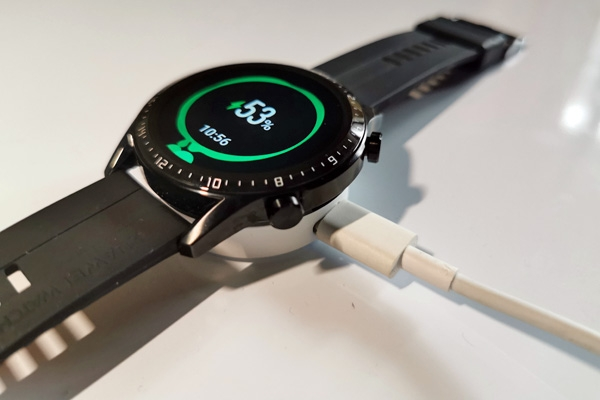 Huawei Watch GT 2 on its charging cradle.