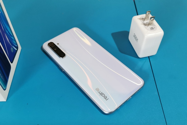 The Realme XT and its VOOC charger.