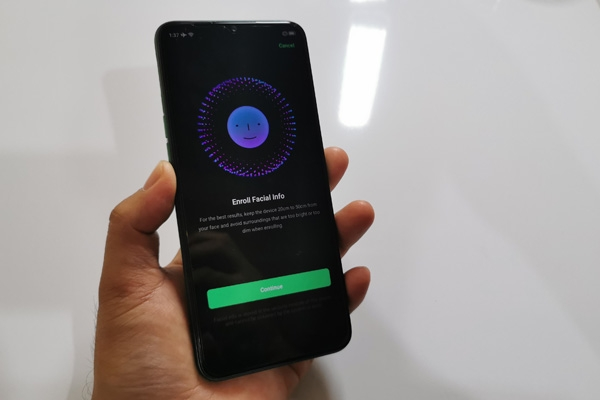Face recognition enrollment screen on the Realme 5i.