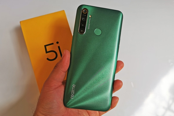 The Realme 5i smartphone and its box.