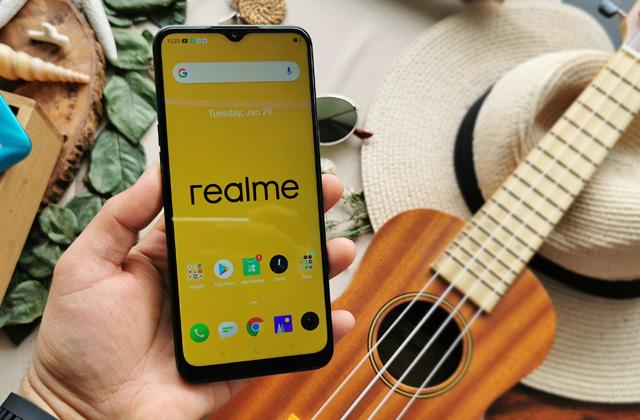 Realme smartphone with Realme wallpaper.