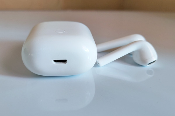 The realme Buds Air Neo's micro-USB charging port.