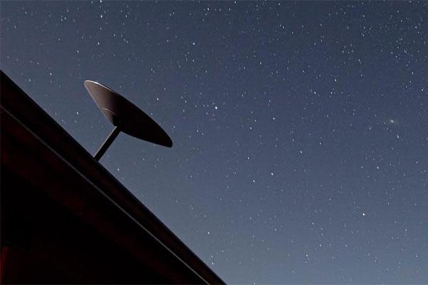 Roof-installed Starlink satellite dish.