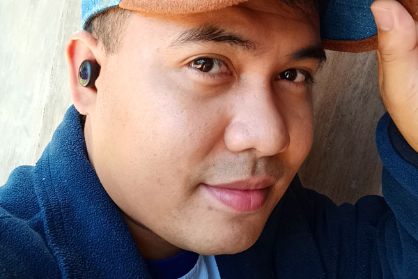 Wearing the realme Buds Air 2 Neo.
