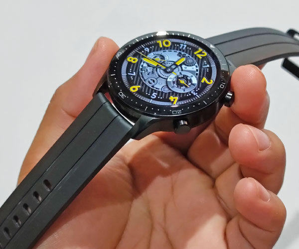 The realme Watch S Pro has a circular display and two physical buttons.