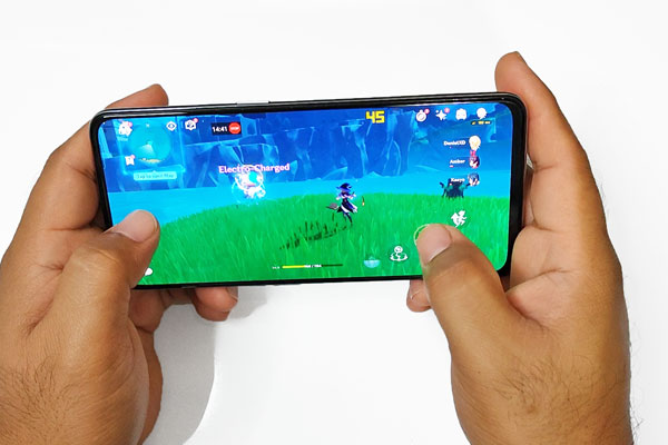 Playing Genshin Impact on the realme GT Master Edition.