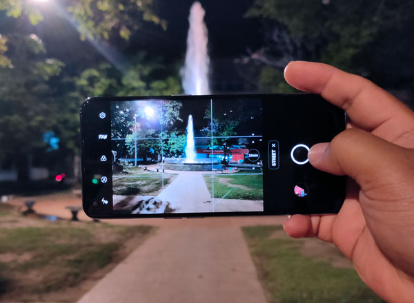Taking pictures using the realme GT Master Edition with Street mode.